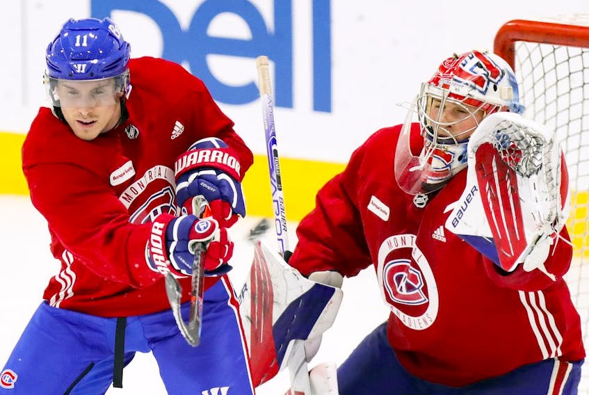 Canadiens' Brendan Gallagher practises tipping pucks in front of goalie Cayden Primeau during training camp at the Bell Sports Complex in Brossard on Tuesday.
