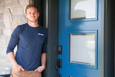 """Add smart locks on all your exterior doors for added protection against intruders. """"We install smart locks on all our projects,"""" Mike Holmes says. Mike Holmes Jr. at the Country House, Holmes + Holmes – 2."""