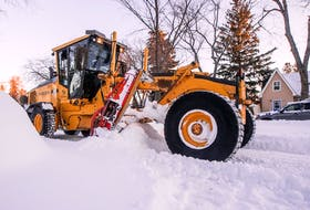 A grader clears a street after a blizzard that resulted in 35-plus centimetres of snow. Photo taken in Saskatoon, SK on Monday, November 9, 2020.