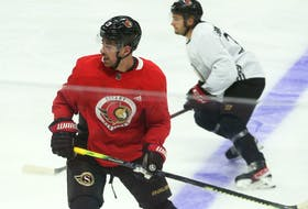 Newly acquired Zach Sanford (red) of the Ottawa Senators during morning practice at Canadian Tire Centre on Tuesday, Sept. 28, 2021.