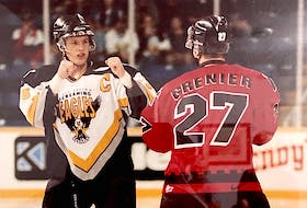 Cape Breton Screaming Eagles defenceman Trevor Ettinger, left, is shown in a heavyweight tilt with Martin Grenier of the Quebec Remparts during Quebec Major Junior Hockey League action at Centre 200 in the late 1990s. Ettinger was an Eagles fan favourite who died by suicide in July 2003. As part of the Cape Breton Post's coverage of the Eagles' 25th anniversary season, we pay tribute to No. 36 and the impact he left on the organization and community.