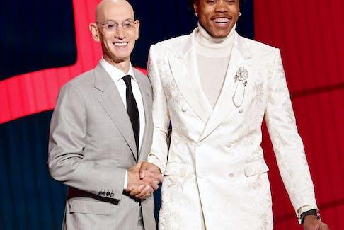 NBA commissioner Adam Silver (left) and Scottie Barnes pose for photos.
