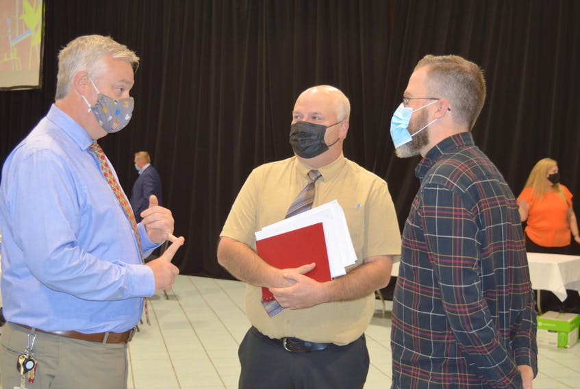 CBRM councillors Steve Gillespie, left, and Darren O'Quinn speak with Grassfire Films producer Nelson MacDonald about the proposed CBRM Artist Grant Program on Tuesday at Centre 200. — IAN NATHANSON/CAPE BRETON POST