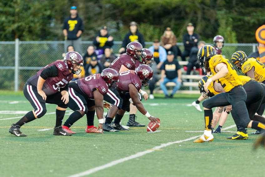 The Holland Hurricanes, left, prepare to snap the ball on offence during an Atlantic Football League (AFL) game against the Dalhousie Tigers at the Terry Fox Sports Complex in Cornwall on Sept. 25. The Tigers won the game 35-0.
