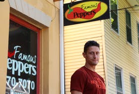 Famous Peppers co-owner David Mitchell stands in front of his pizza parlour on Kent Street. The company has relocated after 10 years at this location to a new spot in the shops of St. Avards plaza on St. Peters Road .