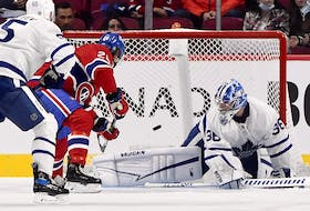 Canadiens forward Christian Dvorak (28) scores a goal against Toronto Maple Leafs goalie Jack Campbell (36) during the first period at the Bell Centre on Monday, Sept. 27, 2021.