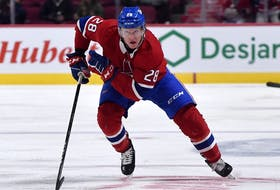 Canadiens forward Christian Dvorak chases the puck  against the Toronto Maple Leafs during the second period at the Bell Centre on Sept. 27, 2021.