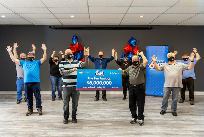 Ten co-workers of the Terrington Co-op in Happy Valley-Goose Bay are splitting a $6 million Lotto 6/49 jackpot. (Photo by Becken Photography, Happy Valley-Goose Bay)