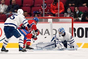 Canadiens' Christian Dvorak scores a goal against Maple Leafs goalie Jack Campbell during the first period at the Bell Centre on Monday, Sept. 27, 2021.