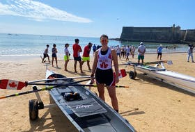 Brienne Miller of Halifax, centre, captured the gold medal at the World Rowing Coastal Beach Sprint Championships in Portugal on Sunday.  - Contributed