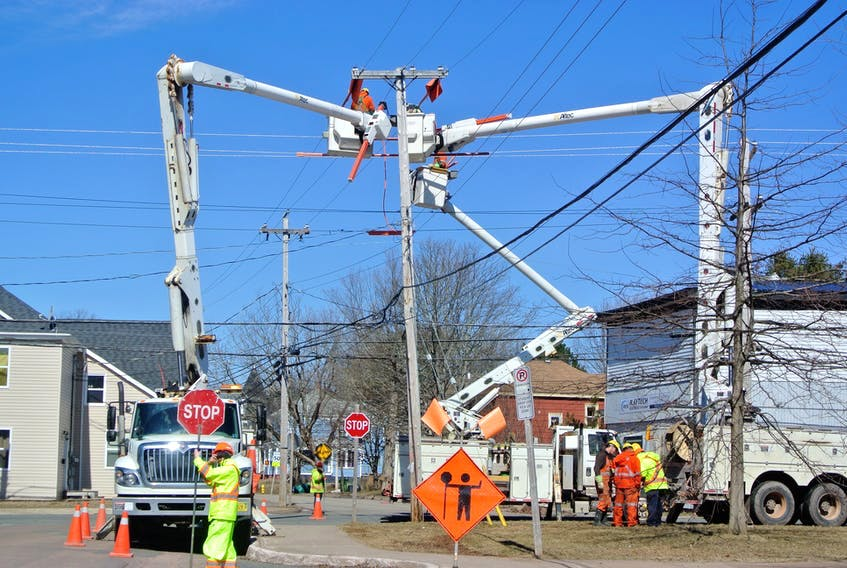 Crews from Nova Scotia Power work on an upgrade at the corner of Academy and Spring streets in Amherst in 2018. File