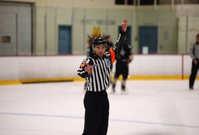 Referee Tanner Doiron keeps an eye on the line changes at a stoppage in play during a Quebec Major Junior Hockey League (QMJHL) pre-season game in Cornwall recently. Doiron, from Summerside, is entering his first season as a QMJHL referee after working the last three years as a linesman.