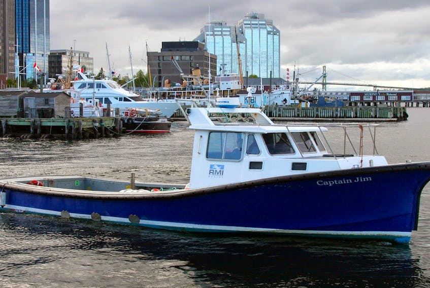 The Captain Jim sank in the approaches to Halifax Harbour early on Jan. 29, 2019. Two crew were rescued and one body was found in the boat by navy divers. Mac Mackay photo