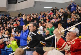 It's been a longtime since fans of the Cape Breton Eagles have been able to take in a game at Centre 200 under somewhat normal conditions. Above, longtime supporter Dennis MacIntyre, wearing an Eagles jersey and ringing a cowbell, leads the crowd in cheering a few years ago at the Sydney facility. The Eagles play their 2021-22 QMJHL season-opening match on Friday when they host the Halifax Mooseheads. DAVID JALA • CAPE BRETON POST