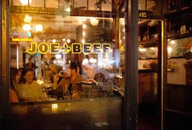 Patrons dine at Joe Beef in Montreal in 2020. Fittingly for trying times, the acclaimed restaurant sells a cookbook titled Surviving the Apocalypse. REUTERS/Christinne Muschi/File Photo