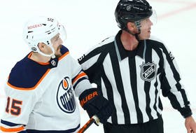 Edmonton Oilers forward Josh Archibald speaks with Winnipeg Jets defenceman Logan Stanley after he hit him low and was penalized in Game 3 of a Stanley Cup playoff series in Winnipeg on Sun., May 23, 2021.