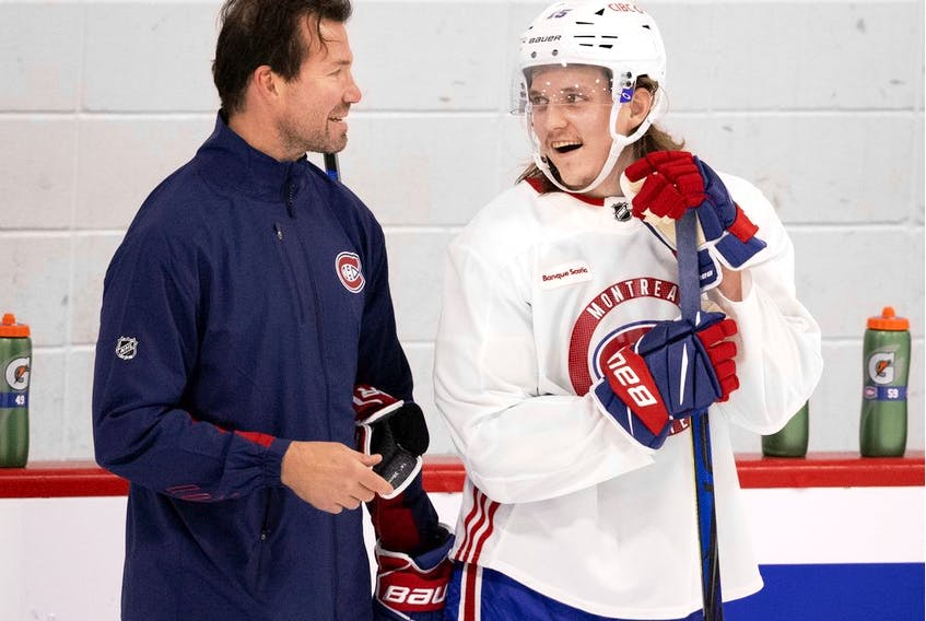 Montreal Canadiens defence prospect Sami Niku speaks with assistant coach Luke Richardson during training camp in Montreal on Sept. 29, 2021.