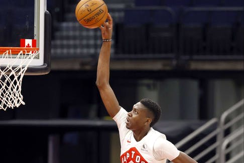 Raptors forward Chris Boucher throws down dunks against the Pistons last season. Boucher could see more minutes early in the season with Pascal Siakam out.