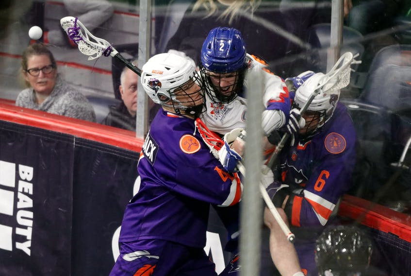 Halifax Thunderbirds defender Graeme Hossack hits Zack Manns of the Toronto Rock into the boards during a National Lacrosse League game on Feb. 21, 2020 at Scotiabank Centre. - ERIC WYNNE / The Chronicle Herald