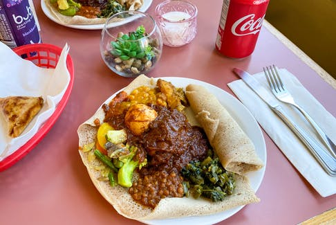 The medium injera veggie combo plus doro wot is pictured is quite plentiful, but also comes in large. GABBY PEYTON PHOTO