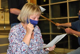 Linda Chaisson reacts with excitement as she reviews the final poll results at Corner Brook City Hall on Sept. 28. Chaisson was the top vote getter in Monday's municipal election.