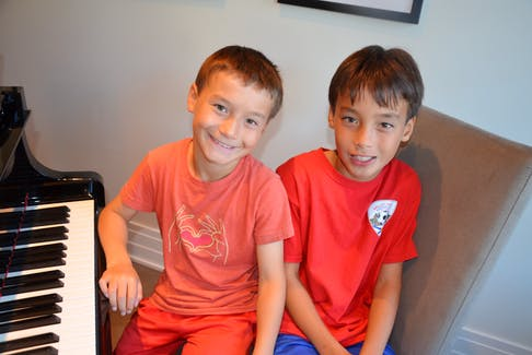 Nine-year-old Benjamin and 11-year-old Nathan Woo of Kentville are both Atlantic Canadian gold medal winners for piano from the Royal Conservatory of Music. KIRK STARRATT