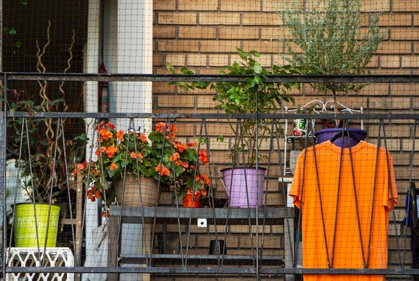 An orange t-shirt hangs on a balcony in Toronto in preparation for the first National Day for Truth and Reconciliation on Thursday, Sept. 30. (Peter J Thompson/National Post)