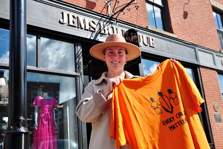 The first National Day for Truth and Reconciliation will be held on Sept. 30. Mi'kmaq Printing and Design has been collaborating with Jems Boutique in Charlottetown this week to sell orange T-shirts to help raise awareness of racism and discrimination experienced by Indigenous people. Cameron Cassidy, an employee at Jem's Boutique, said the Every Child Matters shirts have been very popular and selling very fast. She said the store on Queen Street was lined with customers waiting for shirts on the morning of Sept. 28.