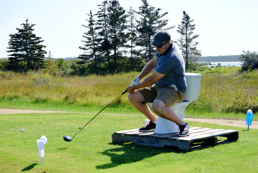 Teeing off while sitting on a toilet bowl was just one of the challenges awaiting golfers at the River Hills Golf and Country Club in Clyde River during the first-ever Superintendent Revenge Scramble on Sept. 22. KATHY JOHNSON
