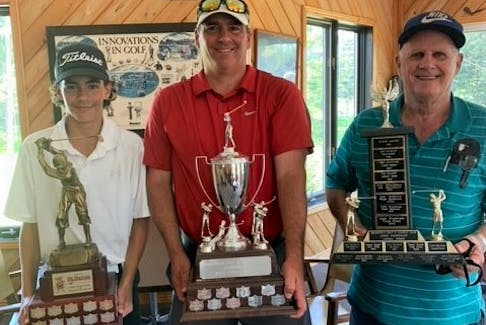 Holding the silverware at the Brookfield Golf & Country Club are Nick Penny (left), the 2021 junior champion, Mike Penny the 2021 men's champion, and Victor Penny who won the 2002 senior men's championship.
