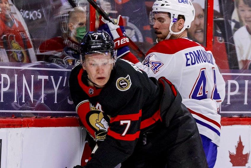 Senators' Brady Tkachuk controls the puck against Canadiens' Joel Edmundson. The Senators and Tkachuk are working hard on getting a new contract done.