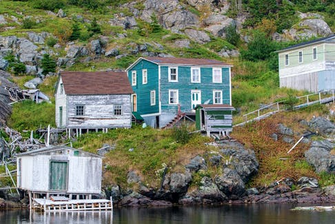 Photograph by John Morris of the eerily quiet coastal community called Round Harbour in Newfoundland. - John Morris Photography
