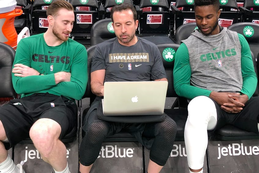 Scott Morrison, centre, chats with the Boston Celtics' Gordon Hayward, left, and Semi Ojeleye at the TD Garden in Boston. Morrison, who worked as an assistant coach with the Celtics from 2017 to 2021, is the new head coach of the Perth Wildcats of the National Basketball League in Australia.