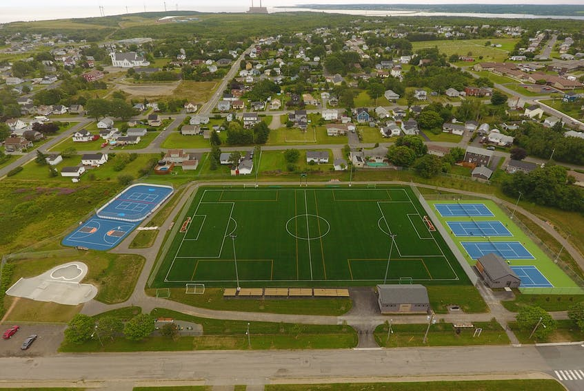 An aerial photo shows the new and improved Gary McDonald Recreation Complex on Eighth Street in New Waterford. On the lower left is the New Waterford Skateboard Park, while upper left shows the Dr. J.A. Roach Memorial Basketball Court and the New Waterford Rotary Ball Hockey Arena. The new, state-of-the-art MacKinnon Memorial Field is located in the middle, while the new New Waterford Tennis Club facility is on the right. The facility is also surrounded by a walking track. PHOTO CONTRIBUTED/NOVA SCOTIA GOVERNMENT