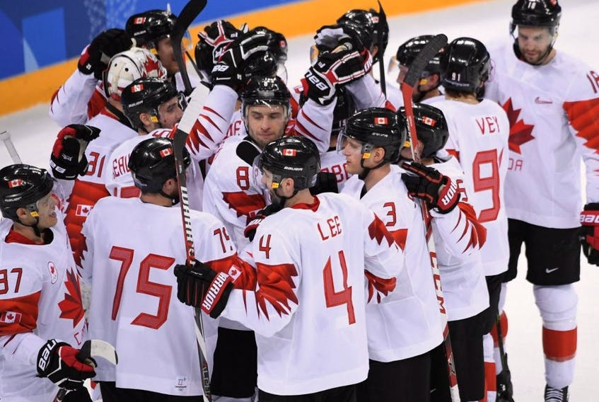 Canada's men's hockey team celebrate winning the bronze medal against the Czech Republic during the Pyeongchang Winter Olympics at the Gangneung Hockey Centre in Gangneung, South Korea, Feb. 24, 2018.