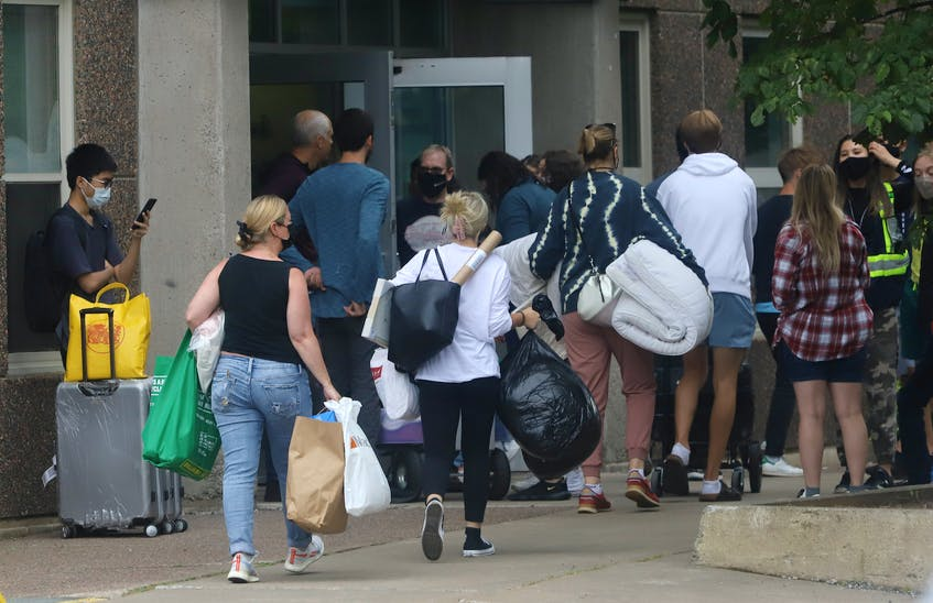 Parents assist their children as they move into the Risley Hall residence at Dalhousie University in Halifax Friday September 3, 2021. The university has limited residence capacity this year due to COVID-19. - Tim Krochak
