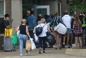 FOR NEWS STANDALONE: Parents assist their children, as they move into the Ridley Hall residence as they prepare for the school year at Dalhousie University in Halifax Friday September 3, 2021.   TIM KROCHAK PHOTO