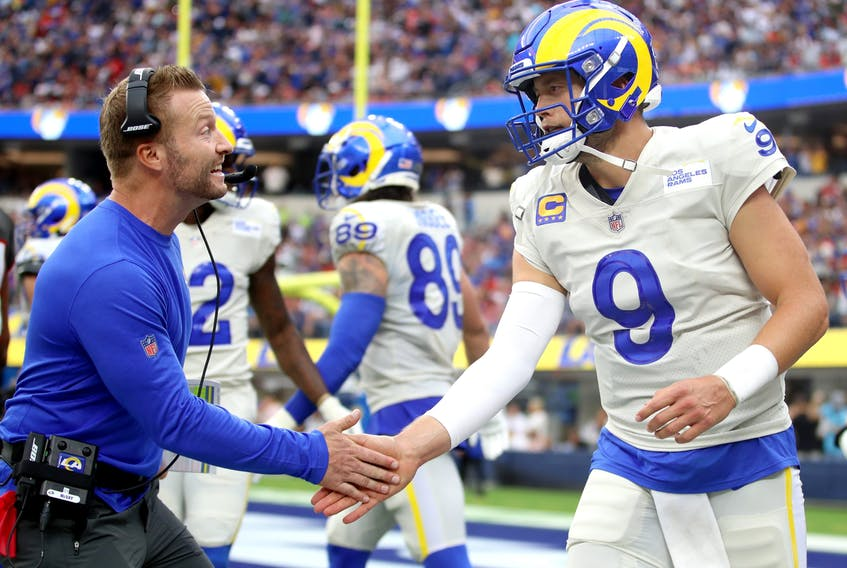QB Matt Stafford,being congratulated by head coach Sean McVay after a third- quarter touchdown  against the Tampa Bay Buccaneers on September 26, 2021, is one reason why the L.A. Rams top our first Power Rankings.