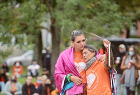 Kyra Gilbert, holds her mother Darleen Thunderbird Swooping Down Woman during a ceremony at Peace and Friendship Park commemorating the first Truth and Reconciliation Day in Canada. Darleen says her mother was a child on the residential school system.