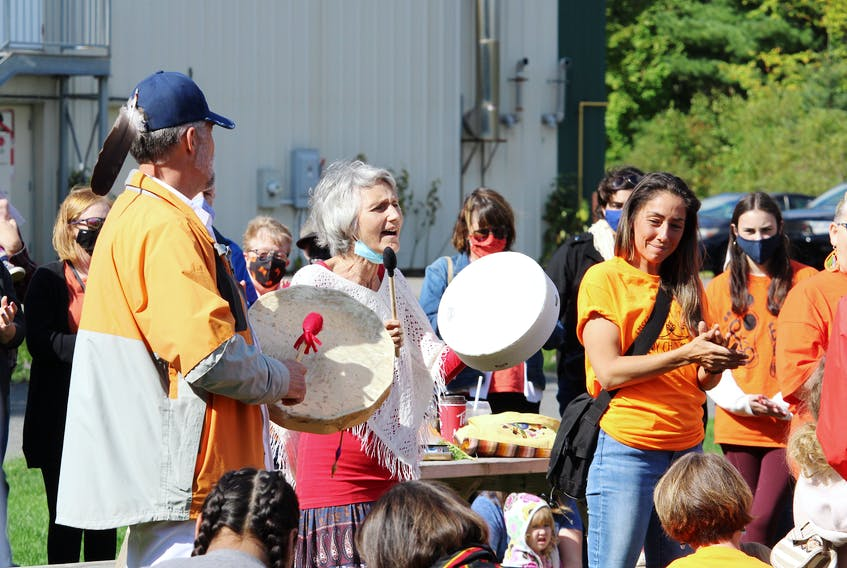 Carolyn Landry, centre, plays a drum and sings during the National Day for Truth and Reconciliation ceremony in Kentville on Sept. 30.