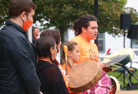 Sean Lush, right, drums and sings during a ceremony for the National Day for Truth and Reconciliation in Charlottetown.