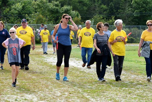 People walk around the Richard Swain Athletic Field in support of the Rosalin Nickerson CARE Fund at the Walk for a Cause fundraiser on Sept. 18. KATHY JOHNSON