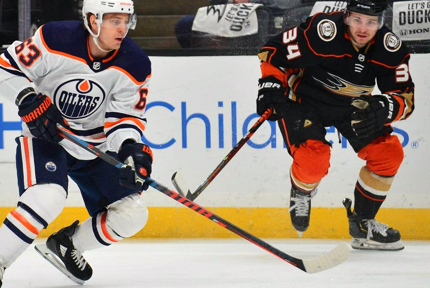 Edmonton Oilers center Tyler Ennis (63) moves in for a shot on goal against the defense of Anaheim Ducks center Sam Steel (34) during the first period at Honda Center.