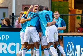 HFX Wanderers players celebrate a goal by Peter Schaale in the second half a 2-0 victory over Forge FC on Friday night at the Wanderers Grounds. - Trevor MacMillan