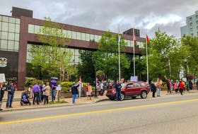 Protesters gathered in front of City Hall in Sydney on Saturday at mid-day in opposition to vaccine and mask mandates as well as vaccine passport systems. JESSICA SMITH/CAPE BRETON POST
