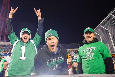 Fans of the Saskatchewan Roughriders cheer on their team as they take on the Calgary Stampeders at McMahon Stadium in Calgary, Alberta, Canada.
