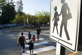 Children walk with their parents to Sherwood Park Elementary in North Vancouver for the first day back-to-school Thursday, September 10, 2020.