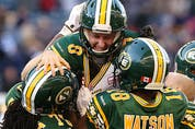Edmonton kicker Sean Whyte (top) is hoisted up by teammates after a 53-yard field goal on the final play of the game to beat the Winnipeg Blue Bombers at IG Field in Winnipeg on Sat., Oct. 3, 2015.