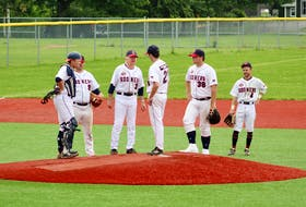 Sydney Sooners manager Jim (Rico) McEachern, third from left, is hoping to guide his squad to a seventh Nova Scotia Senior Baseball League title. The Sooners lead the Kentville Wildcats 2-0 in their best-of-five semifinal series. Above, McEachern chats with rookie hurler Parker Hanrahan on the mound during an August match against the Dartmouth Moosehead Dry in Sydney. From left: catcher Jordan Sampson, third baseman Guy Pellerine, McEachern, Hanrahan, first baseman Brett Sibley and shortstop Chris Farrow. DAVID JALA/CAPE BRETON POST