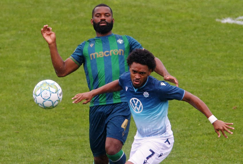 HFX Wanderers' Alex Marshall and York United FC's Jordan Wilson follow a deflected ball during the first half of CPL action at the Wanderers Grounds on Monday. - Tim Krochak